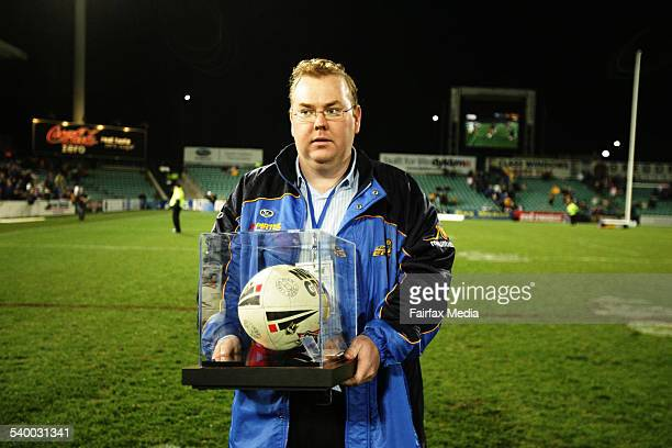 Parramatta's media manager Damien Kelly is left standing with the game ball which was to be presented to Andrew Johns by Jason Taylor for beating...
