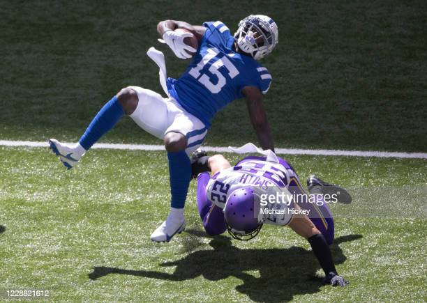 Parris Campbell of the Indianapolis Colts is tackled by Harrison Smith of the Minnesota Vikings during the first half at Lucas Oil Stadium on...