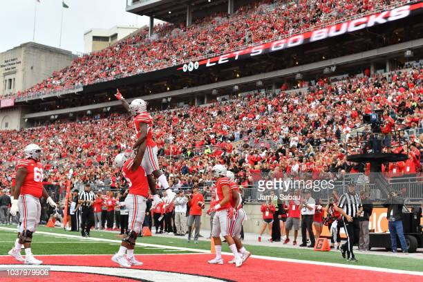 Parris Campbell of the Ohio State Buckeyes celebrates after catching a touchdown pass in the first quarter against the Tulane Green Wave at Ohio...