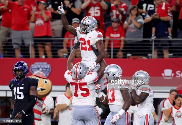 Parris Campbell of the Ohio State Buckeyes celebrates after scoring a touchdown against the TCU Horned Frogs during The AdvoCare Showdown at ATT...