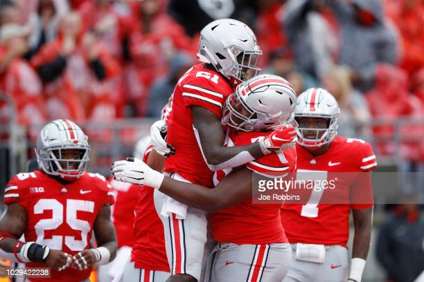 Parris Campbell of the Ohio State Buckeyes celebrates with teammates after a 16yard touchdown reception in the first quarter of the game against the...