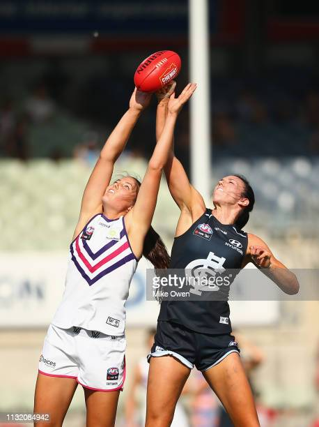 Parris Laurie of the Dockers and Alison Downie of the Blues compete for the ball during the AFLW Preliminary Final match between the Carlton Blues...