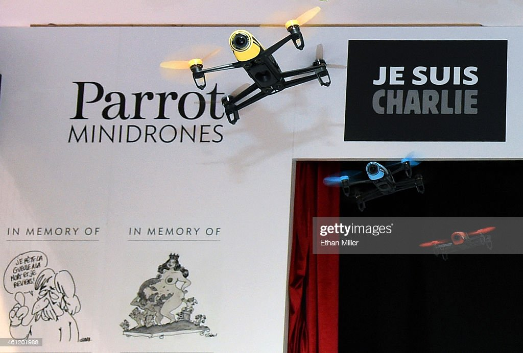 Parrot Bebop Drones fly at the booth of the French company Parrot in front of a 'Je Suis Charlie' sign placed in memory of the 12 victims of the terrorist attack in Paris on Wednesday at the 2015 International CES at the Las Vegas Convention Center on January 8, 2015 in Las Vegas, Nevada. The Bebop has a 14-megapixel fisheye camera and records in full HD 1080p and can stream live video to a smartphone or tablet. CES, the world's largest annual consumer technology trade show, runs through January 9 and is expected to feature 3,600 exhibitors showing off their latest products and services to about 150,000 attendees.