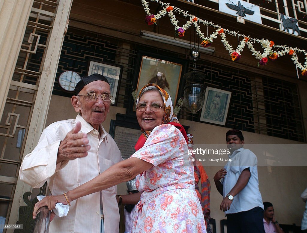 A Parsi Couple greeting each other at the fire temple on the occasion of Navroze - the Parsi New Year in Mumbai, 20 August 2007- Parsis, followers of Zoroastrianism, a small religious community which exists mostly in Mumbai, were exiled from Iran in the 7 : News Photo