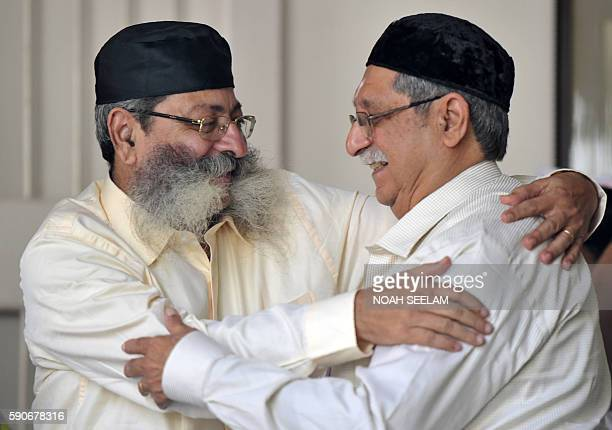 Parsi family members greet each other on the eve of Navrozthe Parsi New Year ceremony at the Fire Temple in Hyderabad on August 17 2016Parsis...