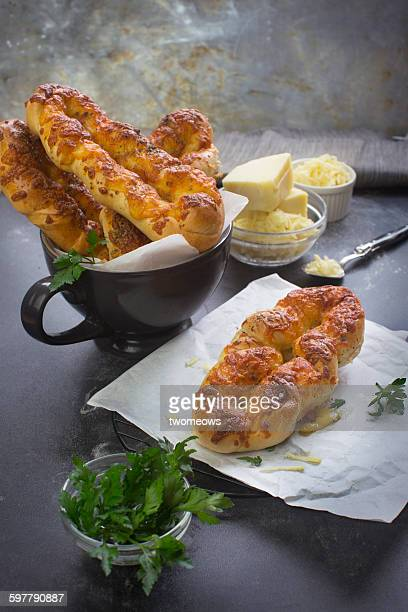 Parsley cheese roll on rustic table top.