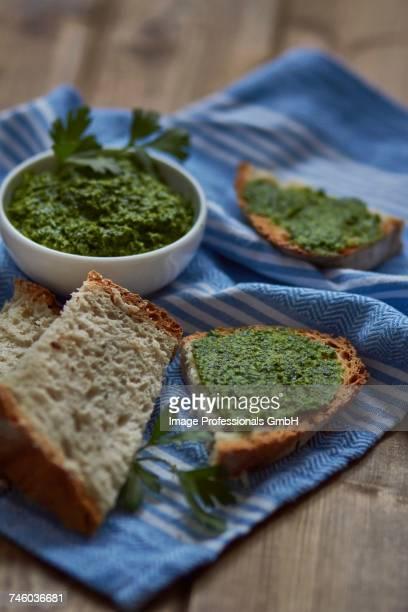 parsley pesto and slices of bread - ピストー ストックフォトと画像