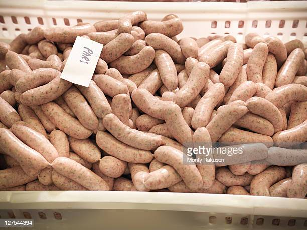 parsley sausages in meat factory - meat processing plant stock pictures, royalty-free photos & images