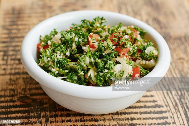 parsley tabbouleh salad, with parsley, tomatoes, onions, bulgur - tabbouleh stock pictures, royalty-free photos & images