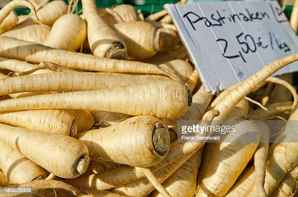 Parsnips are offered for sale at the weekly market beside the river Elbe