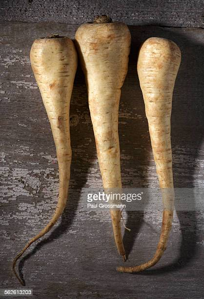 Parsnips on weathered wooden table