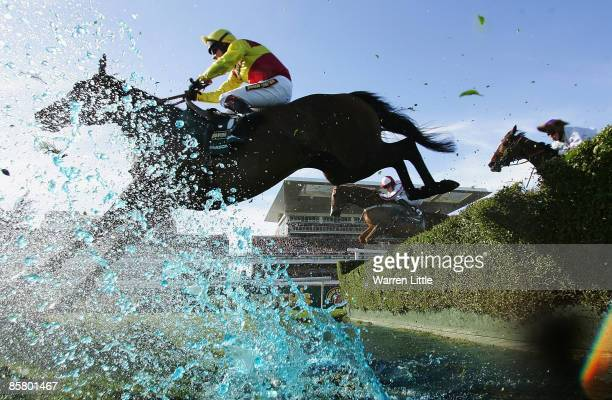 Parson Legacy ridden by Richard Johnson jumps the water jump during the John Smith's Grand National Steeple Chase Handicap at Aintree on April 4 2009...