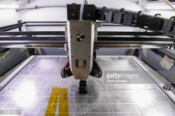 STOP part for the second prototype of a low cost 3D ventilator under priting process is pictured inside the Polish company headquarters Urbicum on...
