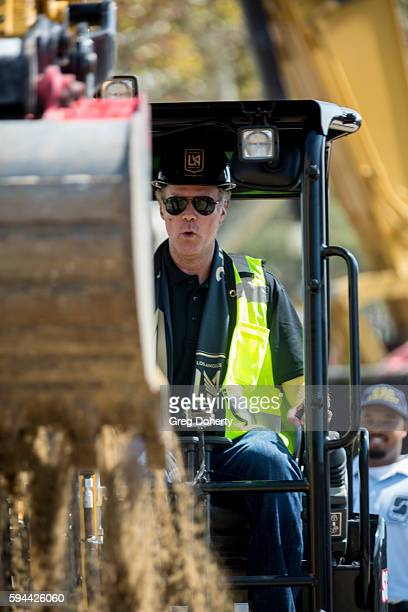 Part LAFC owner Actor Will Ferrell operates a digger at the Los Angeles Football Club Stadium Groundbreaking Ceremony on August 23 2016 in Los...