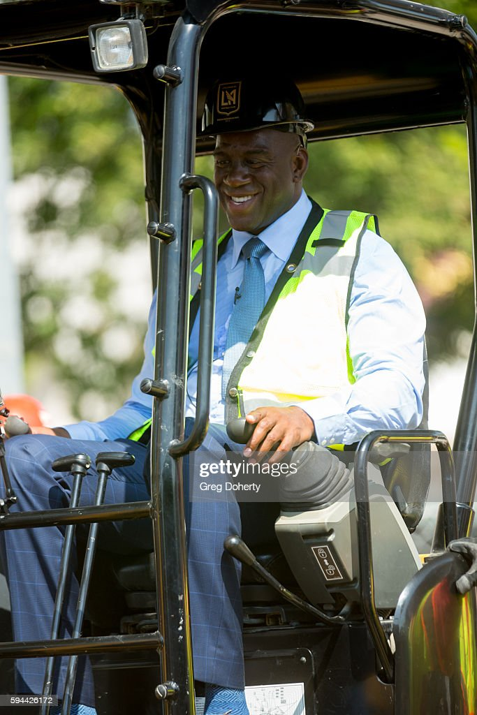 Part LAFC owner Earvin 'Magic' Johnson operates a digger at the Los Angeles Football Club Stadium Groundbreaking Ceremony on August 23, 2016 in Los Angeles, California.