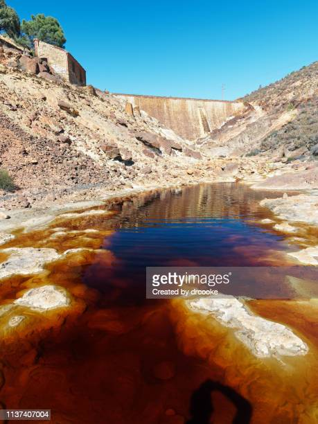 part od rio tinto river just by one of the mine's dams - acid warning stock photos and pictures