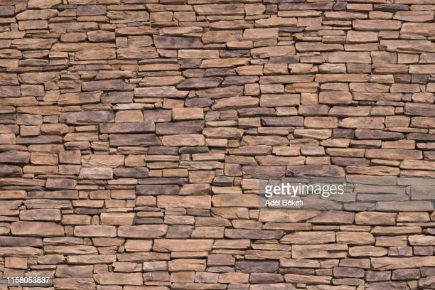 part of a brick wall - stone wall stock pictures, royalty-free photos & images