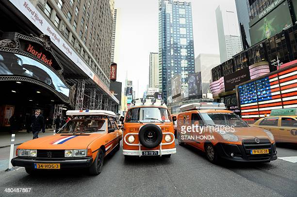 """Part of a caravan of 22 orange vehicles begin a 15,600-mile , 80-day, 14-country """"Oranje Trophy"""" tour on March 25, 2014 from New York's Times Square..."""