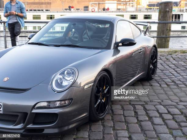 Part of a dark gray metallic Porsche Carrera parked at the Magnus Walker event in Hamburg on the Fish Market