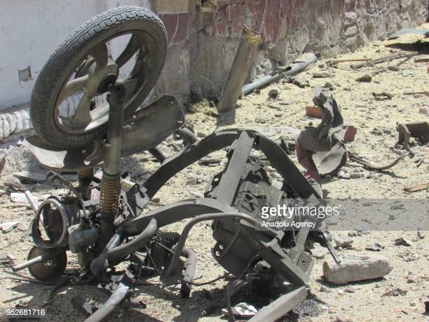 A part of a destroyed vehicle is seen near an election registration center after a bomb attack which injured 6 in capital of Nangarhar province...