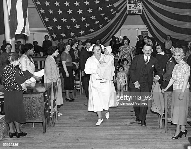 Part of a fashion parade at the largest WPA sewing shop in NY where 3,000 women produce clothing and linens to be distributed among the unemployed,...