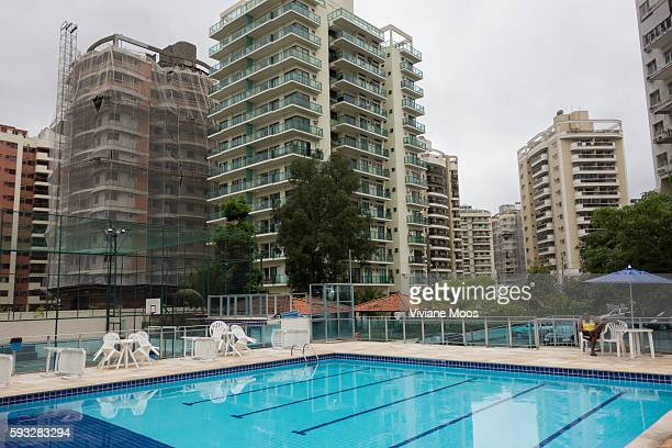 Part of a gated community amenities a swimming pool with guard tennis and basketball courts are all part of Barra da Tijuca famous new borough in the...
