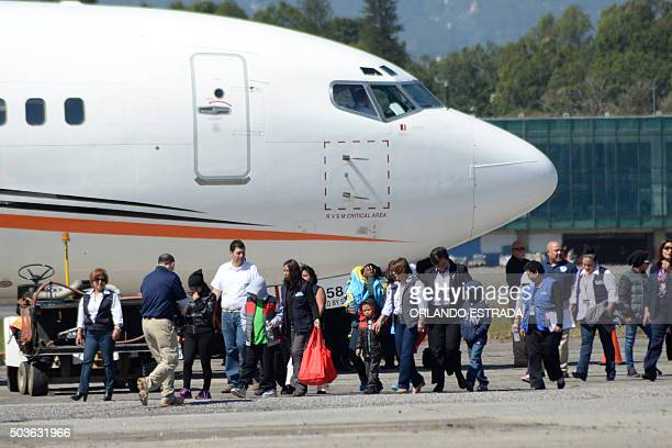 Part of a group of 14 Guatemalans deported from the United States alight from the airplane upon their arrival at the air force base in Guatemala City...