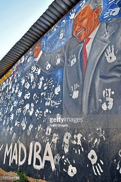 Part of a mural of Madiba with schoolchildren's hand prints on the walls of a house in Alexandra Township where Nelson Mandela rented a room when he...
