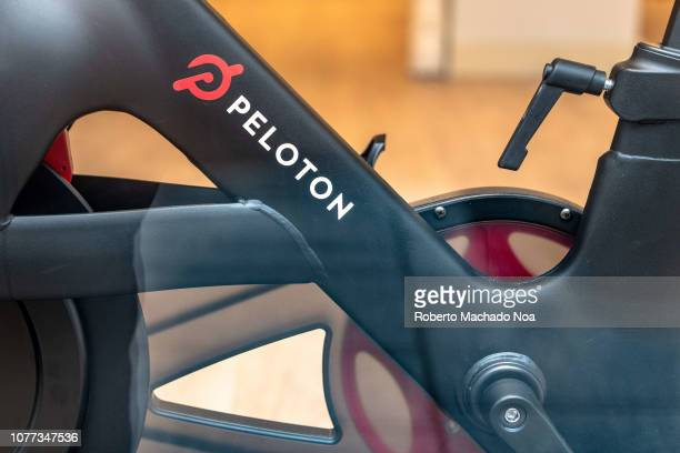 Part of a 'Peloton' gym bicycle which is in exhibit on a luxurious store located in Yonge Street. Downtown district of the Canadian city.