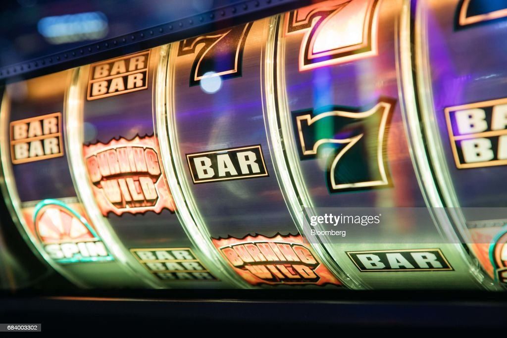 Part of a slot machine is seen at the Global Gaming Expo (G2E) inside the Venetian Macao resort and casino, operated by Sands China Ltd., a unit of Las Vegas Sands Corp., in Macau, China, on Tuesday, May 16, 2017. The gaming expo runs through May 18. Photographer: Anthony Kwan/Bloomberg via Getty Images