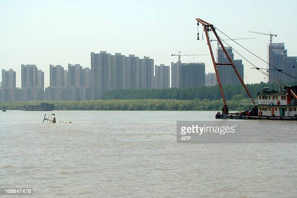 A part of a sunken vessel ship is seen on the water on May 13 2013 in Nanjing east China's Jiangsu province after it hit a bridge on the Yangtze...
