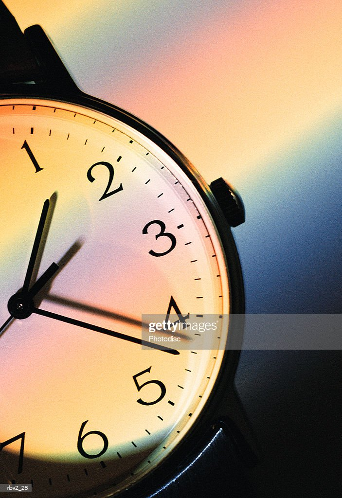 part of a watch face can be seen as many colors run across it : Foto de stock