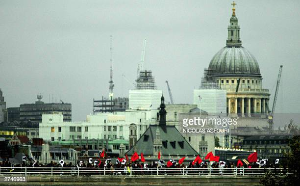 Part of an estimated 100000 demonstrators cross Waterloo bridge to protest the state visit of US President George W Bush to Britain as St Paul's...