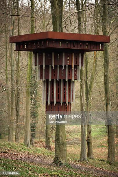 Part of an installation entitled 'Super Kingdom' hangs in trees in King's Wood as part of the Stour Valley Arts project on March 31 2011 in Challock...