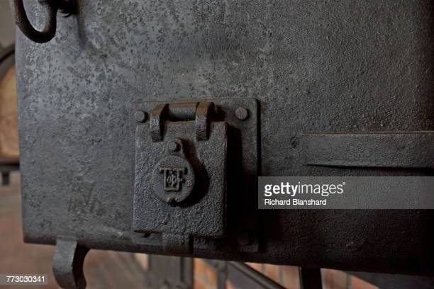 Part of an oven door in the crematorium at the Buchenwald German Nazi concentration camp near Weimar Germany 2014 At centre left is the trademark of...