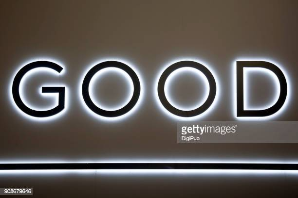 "Part of back lit illuminated sign ""GOOD"""
