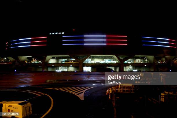 Part of Charles de Gaulle Airport illuminated with the colours of the French flag in Paris France on November 23 2017