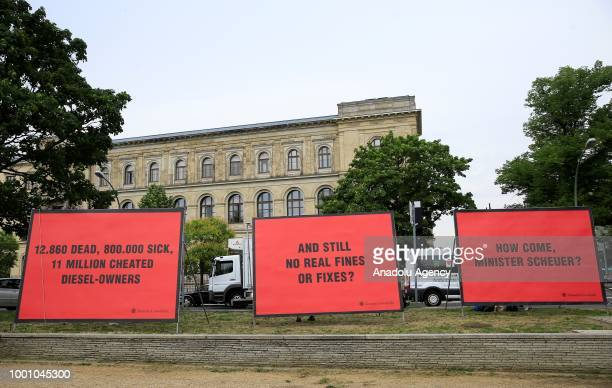 A part of German Environmental Action members place big banners in front of the Ministry of Transportation building to protest with a claim of the...