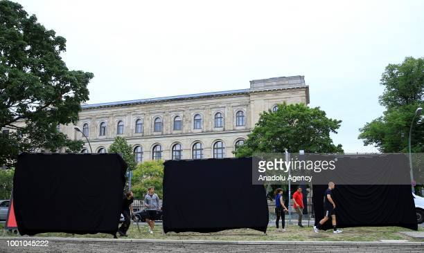 A part of German Environmental Action members place big banners with black outer cover in front of the Ministry of Transportation building to protest...