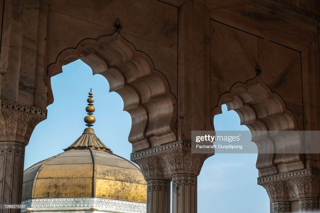 A part of golden roof of Musamman Burj look through door frames with clear blue sky at Agra Fort, India : Stock Photo