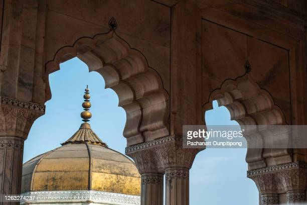 a part of golden roof of musamman burj look through door frames with clear blue sky at agra fort, india - agra jama masjid mosque stock pictures, royalty-free photos & images