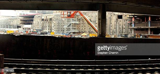 Part of ground zero is visible as a PATH train pulls in to the newly rebuilt World Trade Center PATH Station November 23 2003 in New York CityThe...