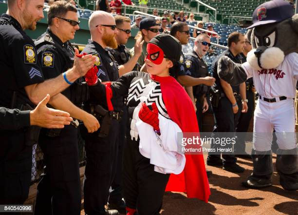 Part of his 'Make a Wish' wish Sawyer Fish 10 of Falmouth in action as Sonic Spider Boy high fives members of the Portland Police after the super...