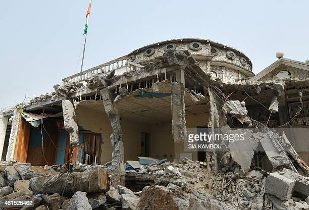 A part of Ivorian musician Alpha Blondy's house lies in ruins in Abidjan on January 14 2015 after it was destroyed as part of a demolition campaign...
