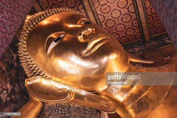a part of reclining buddha statue in wat pho , bangkok , thailand . - wat pho stock pictures, royalty-free photos & images