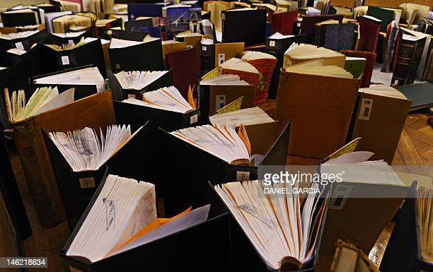 Part of the 11000 books that were damaged by a leak due to a broken water pipe in the library of the Legislature of Buenos Aires are dried in one of...