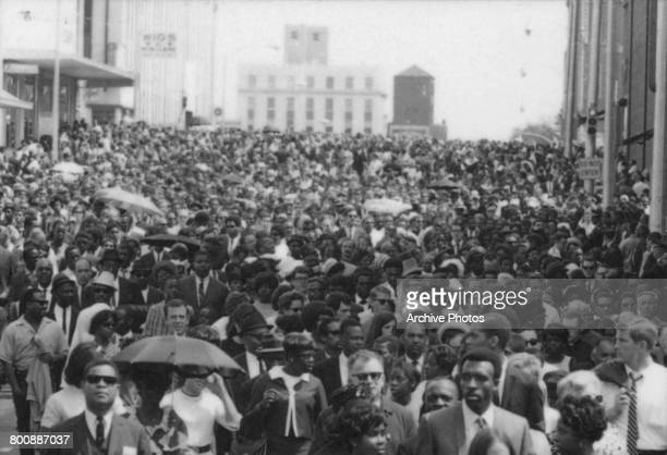 Part of the 150000strong crowd following the coffin of assassinated American civil rights leader Martin Luther King Jr between a private service at...