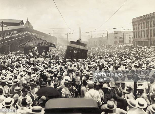 Part of the 20000 persons crowded in Canal Street just before strikers and sympathizers burned the trolley car with which the public Service Company...