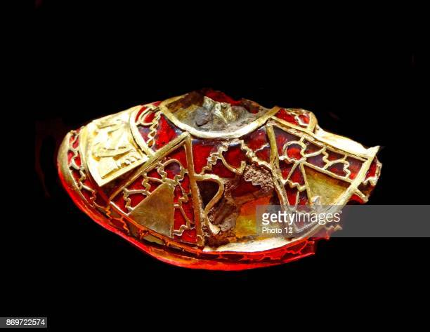 Part of the boss from a shield the lid to a Christian chalice or the stopper to a drinking horn from the Staffordshire Hoard Decorated with very fine...
