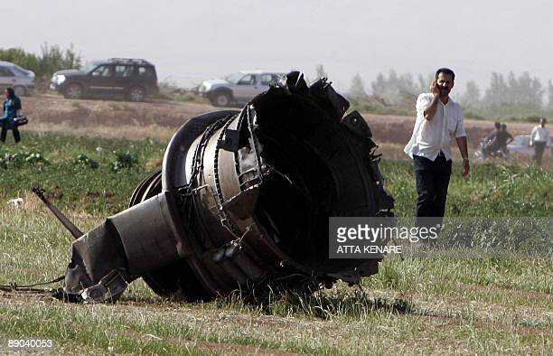 Part of the Caspian Airlines plane which fell into farmland near the city of Qazvin northwest of Tehran is seen at the crash site on July 15 2009 The...